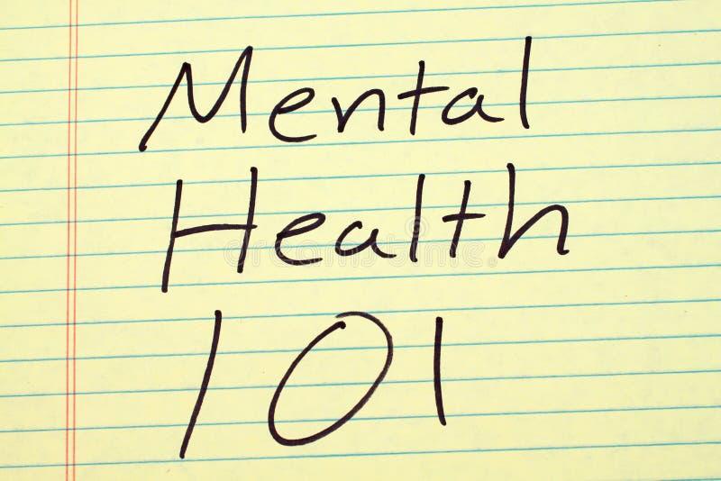 Psychische Gesundheit 101 auf einem gelben Kanzleibogenblock stockfoto