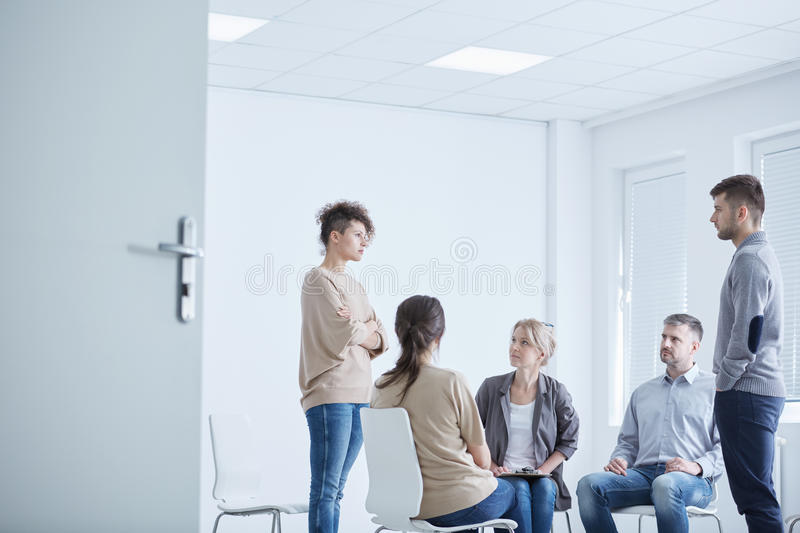 Psychodrama therapy session. With young men and woman royalty free stock images
