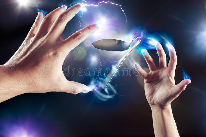 Psychokinesis concept with bent spoon stock images