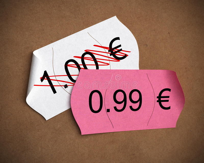 Psychological price - pricing. 0.99 Euro psychological price written on a pink label upon another one where it's written 1.00 euro, brown kraft paper background stock illustration
