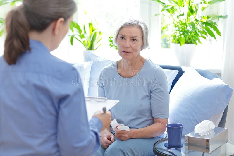 Psychological therapy counselor senior client stock photos