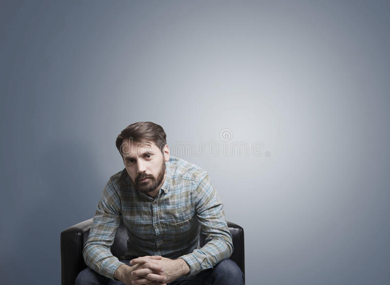 Download Psychologist In Armchair Near Gray Wall Stock Photo - Image: 83722792