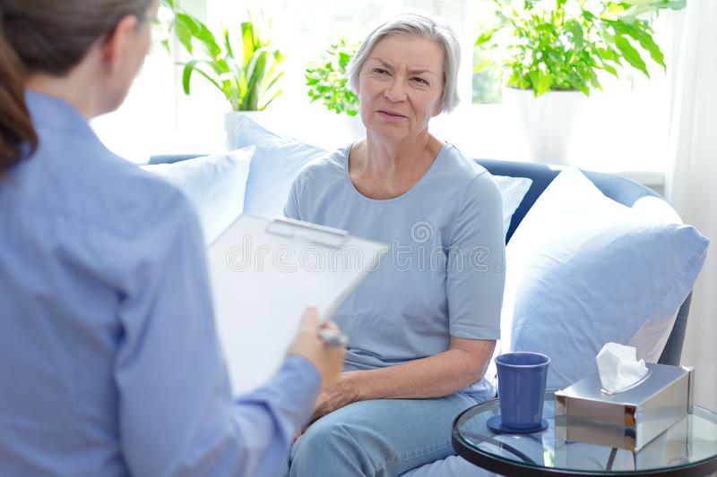 Psychologist counseling therapy patient upset royalty free stock photos