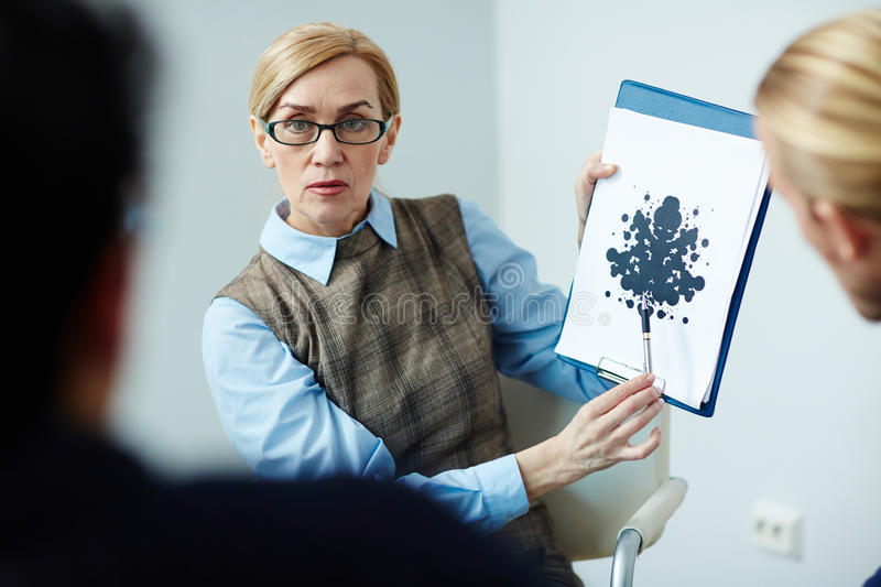 Psychologist Demonstrating Rorschach test royalty free stock images