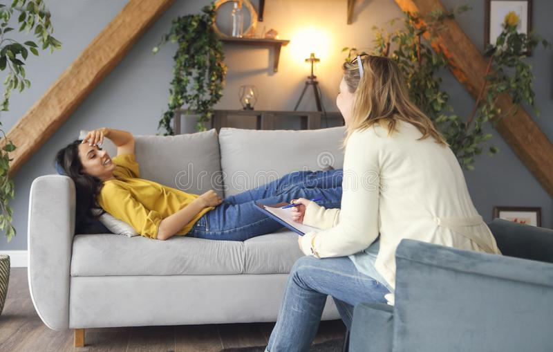 Psychologist having session with her female patient stock images