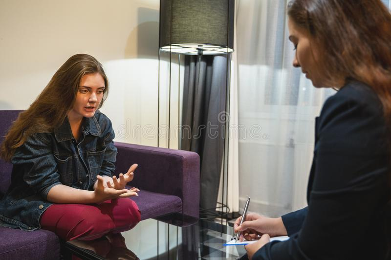 Psychologist or psychotherapist doctor consults young woman patient on therapy session or counsels of mental health stock images
