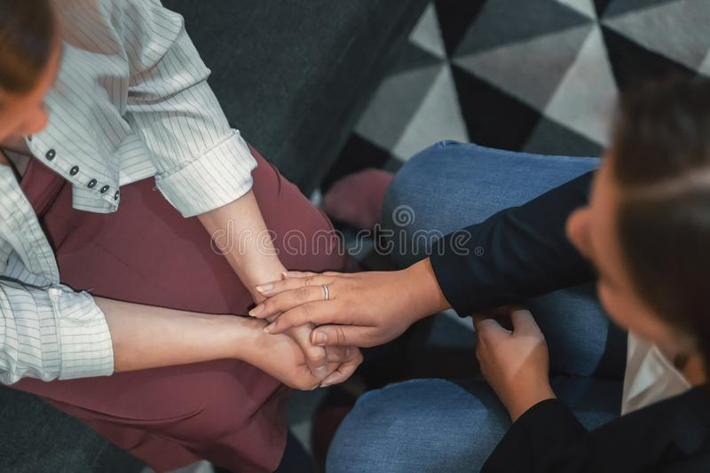 Psychologist session, close up on hands of doctor and patient, mental health, support and counseling concept.  stock image