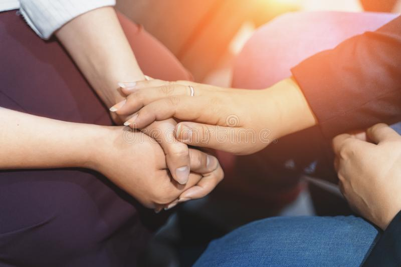 Psychologist session, close up on hands of doctor and patient, mental health, support and counseling concept. Toned stock photo
