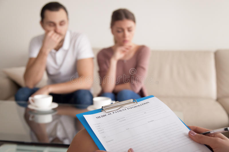 Psychologist starting therapy session with unhappy couple, famil stock photo