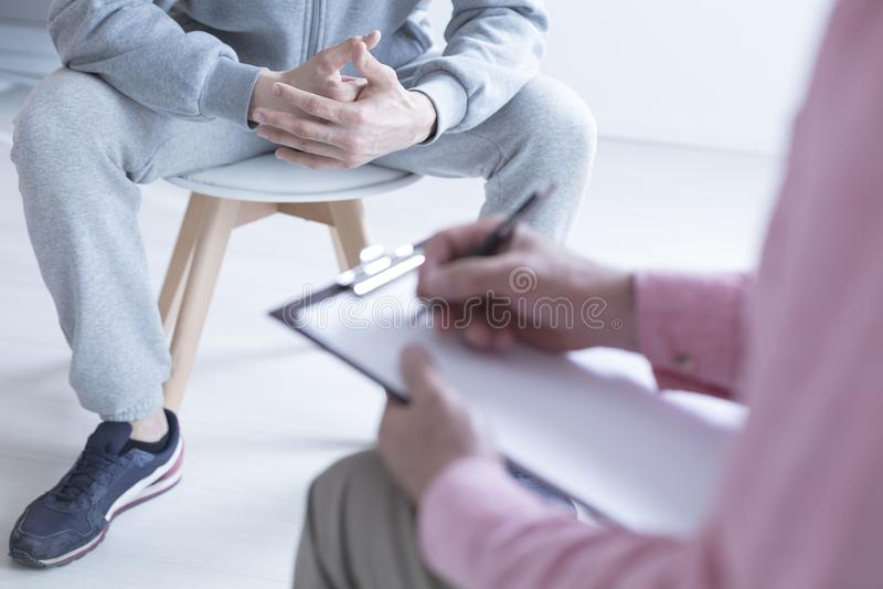 Psychologist taking notes stock image