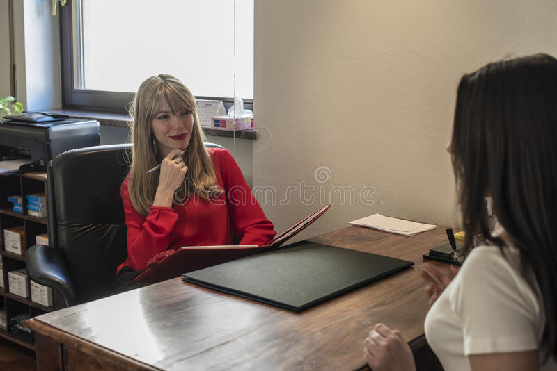 Psychologist. Young girl talking with a psychologist stock image