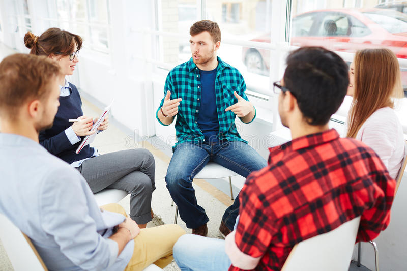 Psychology group. Therapist speaking to a rehab group at therapy session stock photography