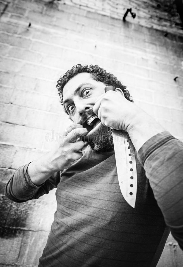 Psychopata z nożem fotografia stock