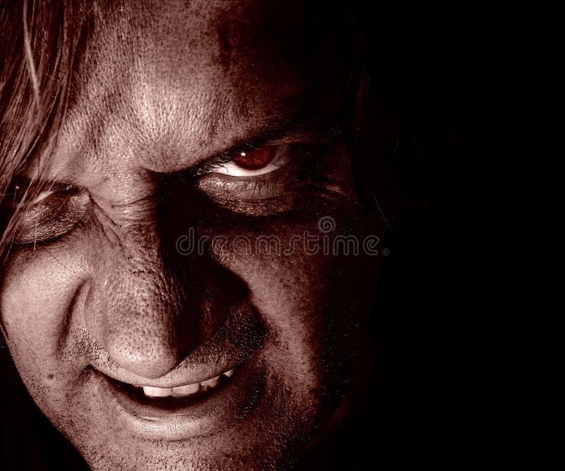 Psychopathe dans l'obscurité image libre de droits