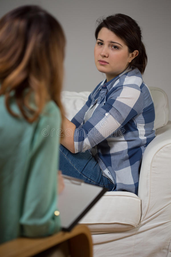 Psychotherapy session at home. Young women during psychotherapy session at home royalty free stock image