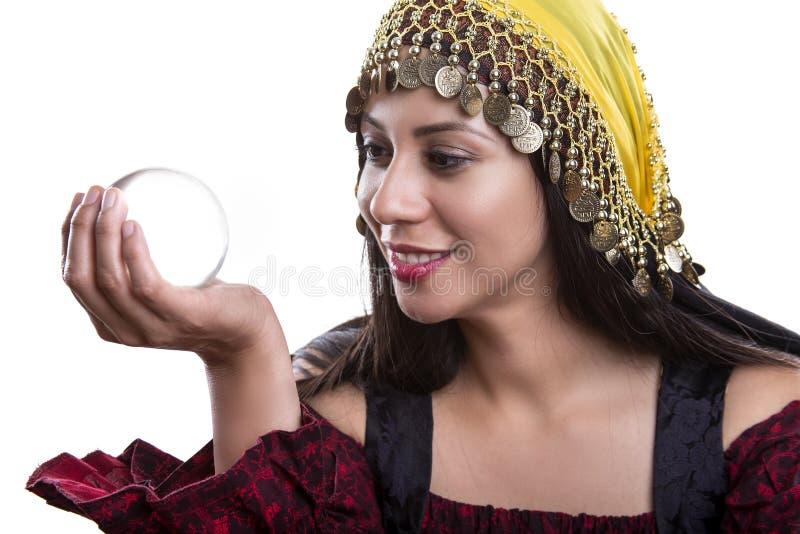 Psykiska Looking in i Crystal Ball royaltyfria foton