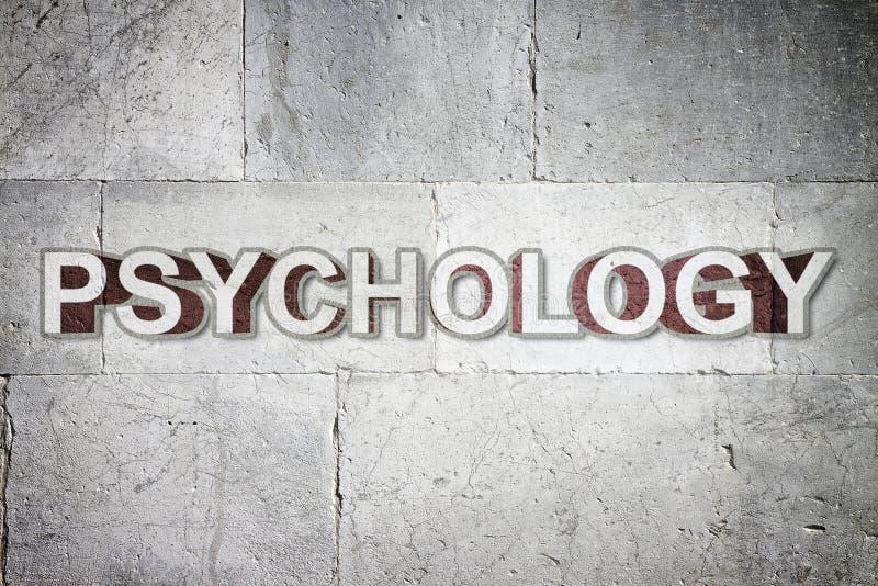 Psykologi som är skriftlig på en stenvägg - begreppsbild fotografering för bildbyråer