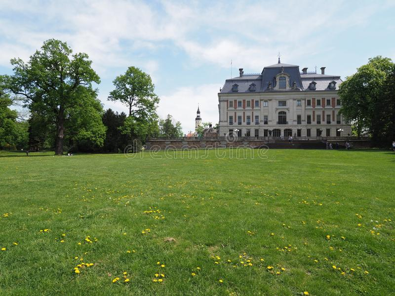Wonderful view of beautiful antique neo baroque castle museum at park of european Pszczyna city in Poland. PSZCZYNA, POLAND on MAY 2018: Wonderful view of stock photos