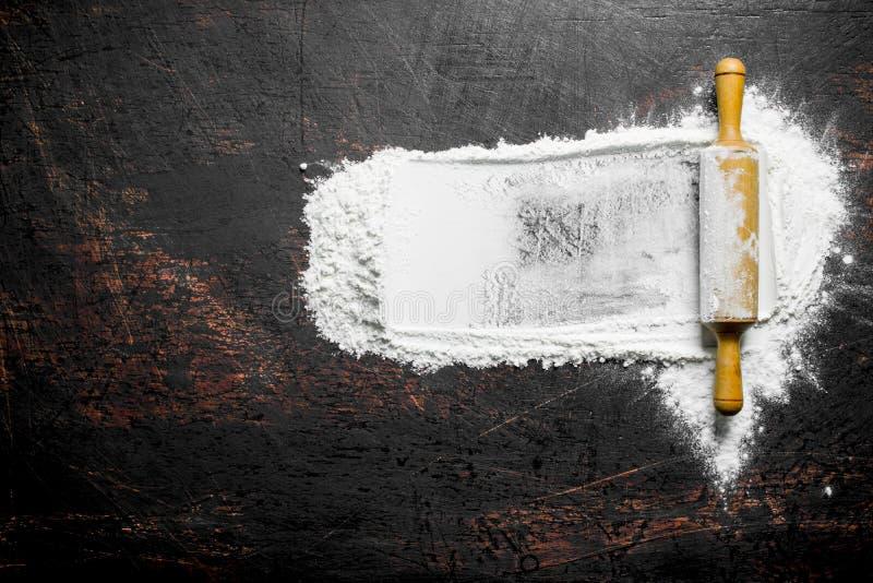 Pszeniczna mąka z toczną szpilką fotografia royalty free