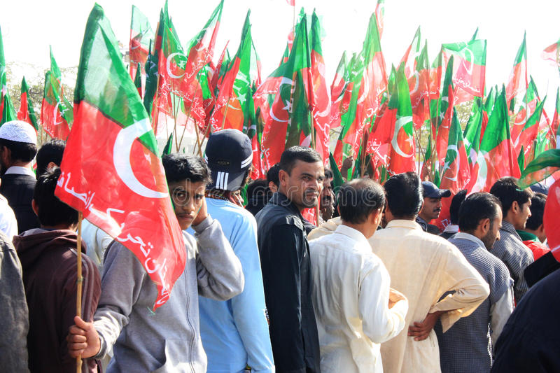 PTI Supporters entering Rally in Karachi, Pakistan. Supporters of PTI (Pakistan Tehreek e Insaf), the party founded by former Cricketer Imran Khan, line up to stock photo