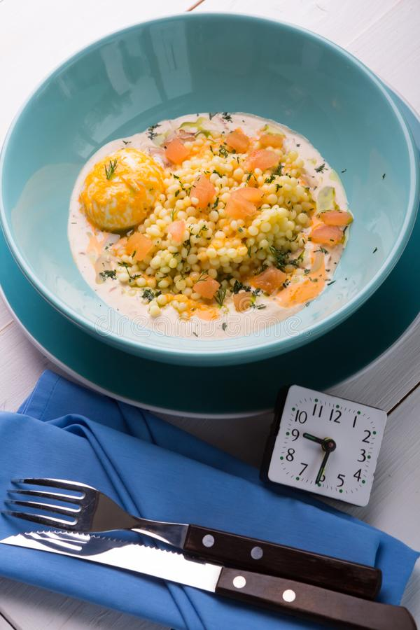 Ptitim pasta cooked as carbonara dish royalty free stock photography