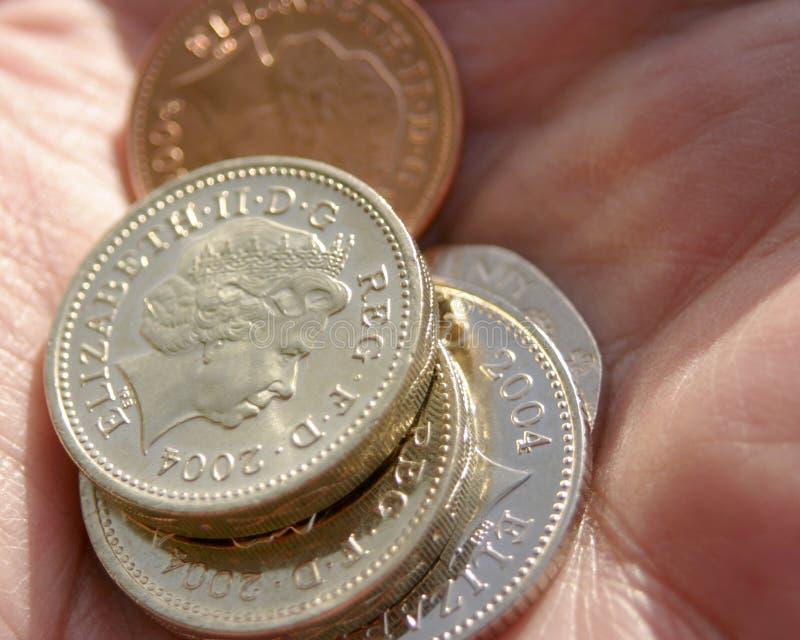 Puñado de monedas fotografía de archivo