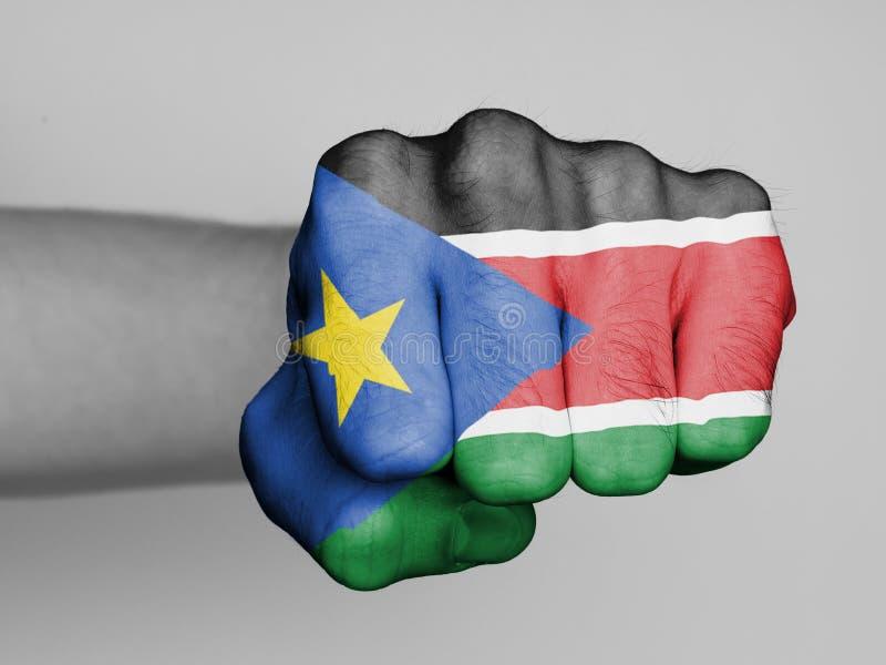 Puño de un hombre que perfora - Sudán del sur foto de archivo