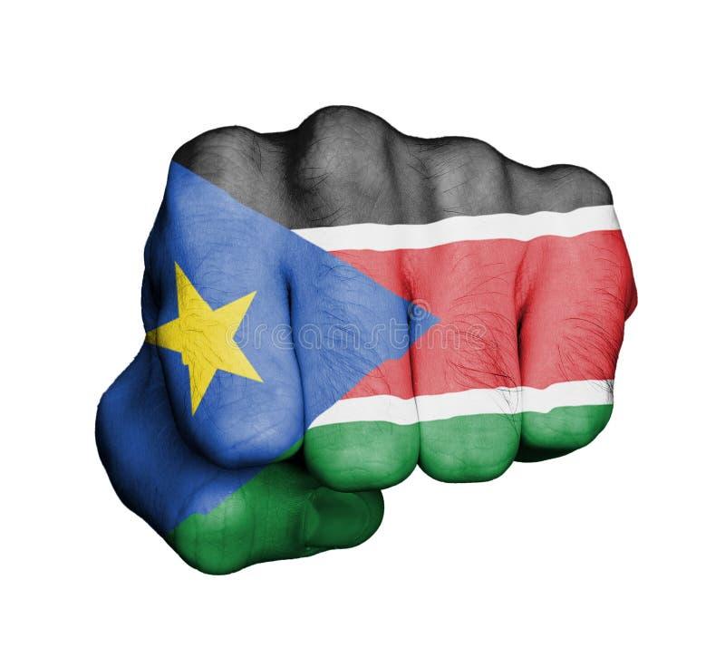 Puño de un hombre que perfora - Sudán del sur imagen de archivo