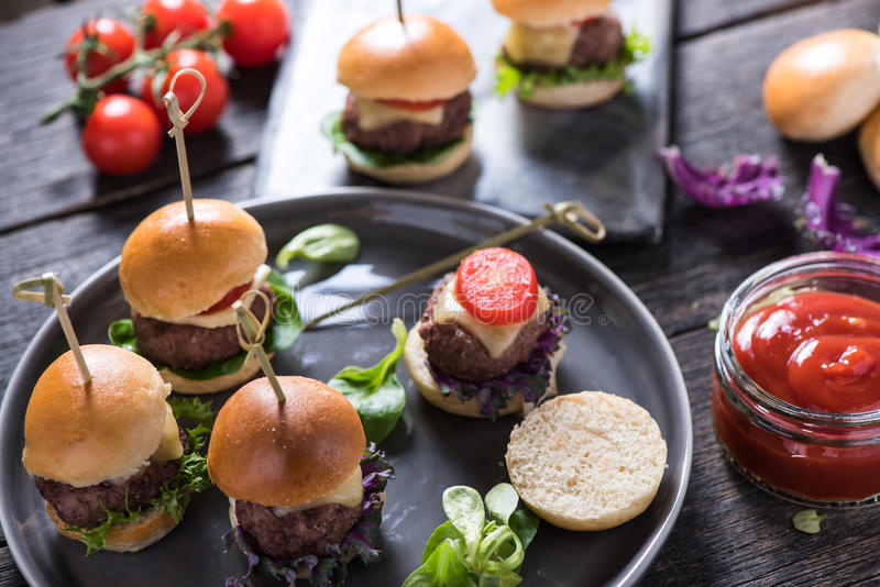 Pub food, mini beef burgers. With cheese royalty free stock photos