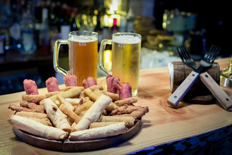 Pub Food. Served with cold beer at bar counter royalty free stock photos