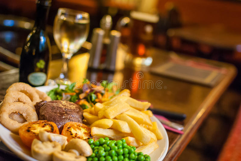 Pub food. Traditional pub food and drinks stock photos