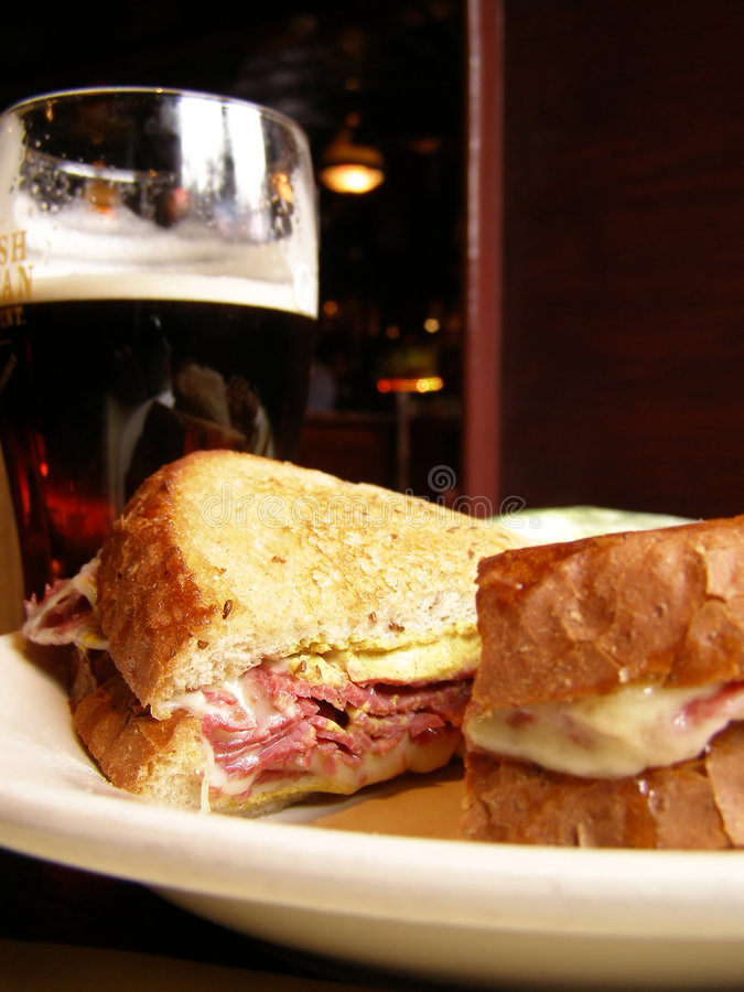 Pub Lunch. Corned Beef Sandwich and a Pint of Dark Beer royalty free stock photos
