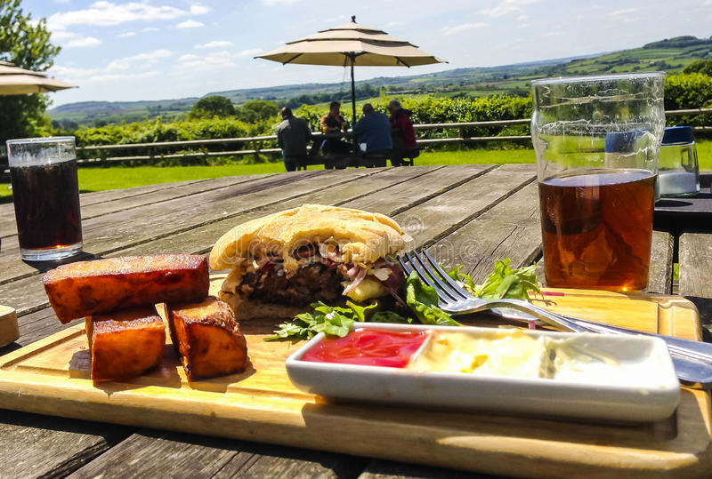 Pub lunch. With a Beef burger and pint of beer royalty free stock image