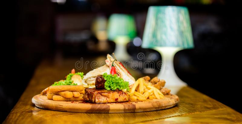 Pub menu snack. High calorie snack for group friends. Tasty delicious snacks. Snack for beer. Restaurant food. Wooden royalty free stock images