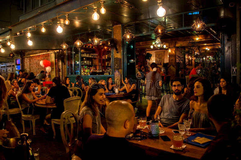 Pub night life in Tel Aviv, Israel. At night in Tel Aviv the pubs spill out into the streets, crammed with young people enjoying Tel Aviv`s vibrant night-life royalty free stock images