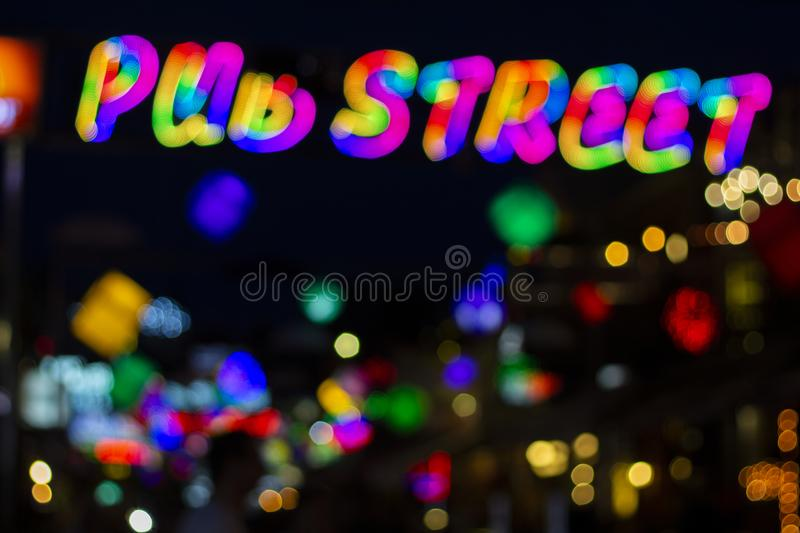 Pub Street in Siem Reap, Cambodia - blurry abstract photo of colorful night lights. Outdoor night life blurred view. Glowing illumination of party clubs and royalty free stock images