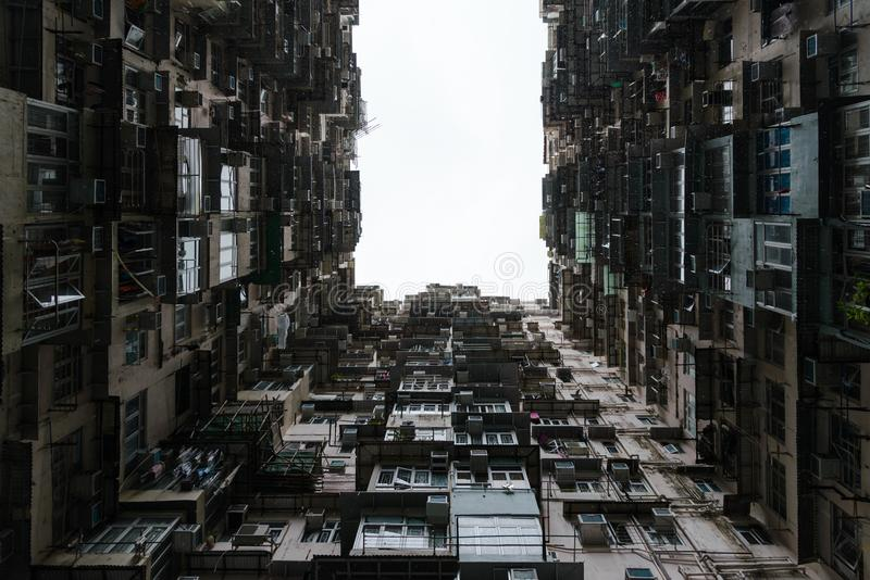 Public apartment block in Hong Kong. Angle of elevation stock photography