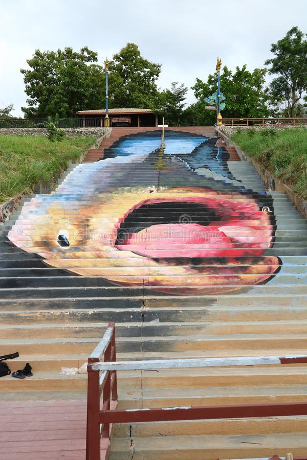 Public artwork of the Mekong giant catfish. On the steps down the Mekong River bank stock photos