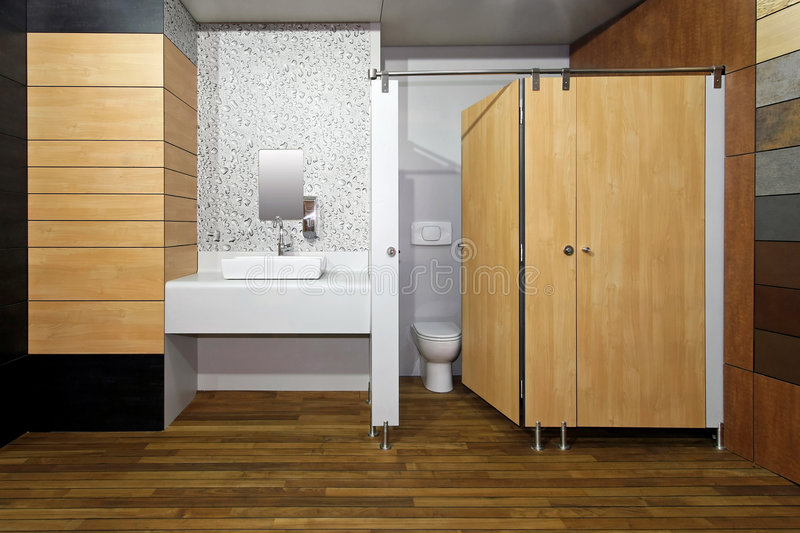 Public bathroom. New public toilet room with double cabins stock images