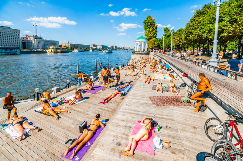Public beach in Moscow Gorky park. Moscow, Russia. 19th July 2014: Public beach in Moscow Gorky park. It is not allowed to swim in the river but you can bake in stock photos
