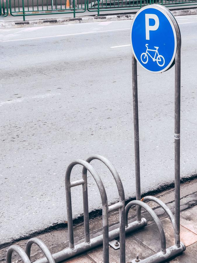 Public bicycle parking on the sidewalk. Is located on the side of the road stock image