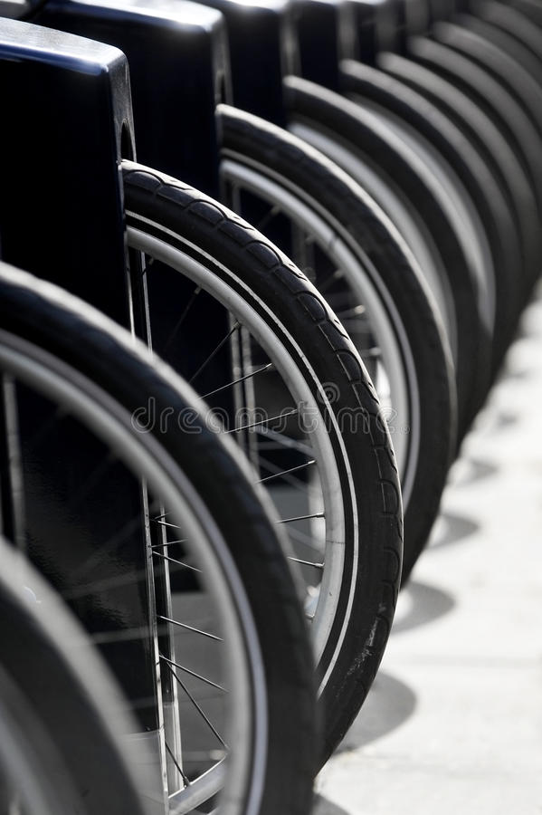 Public bicycles point. Bicycles wheels are seen in a public bicycle point royalty free stock photography