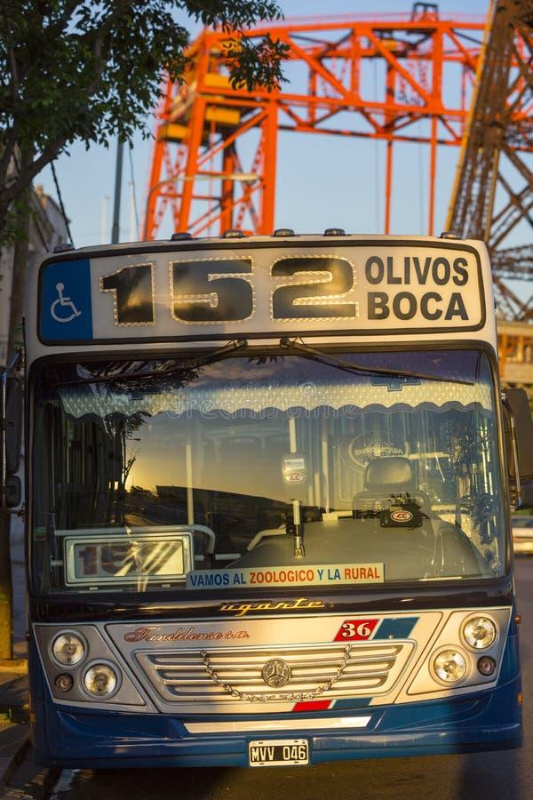 Public bus 152 La boca, Buenos Aires, Argentina. BUENOS AIRES, ARGENTINA, NOVEMBER 23: urban public bus 152 in La Boca with Nicolas Avellaneda bridge in the royalty free stock images