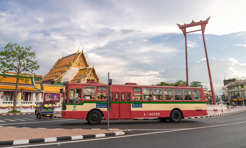 A public bus on street at the Giant swing or Sao Ching Cha the  landmark of bangkok city. Thailand: 03/07/2019 stock photos
