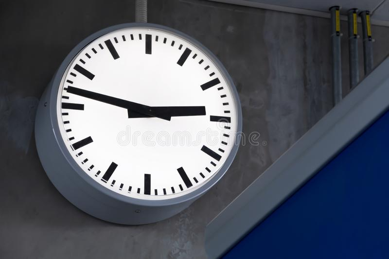 Public clock in railway station at the hanging with roof of subway central station. It is clock for watch time waiting train stock photos