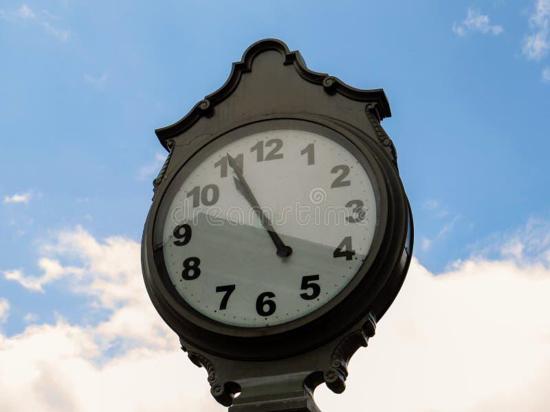 Public clock with sky in background. Elegant Public clock with sky in background stock image