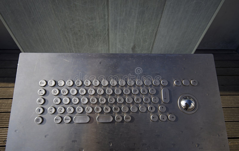 Public Computer. Keyboard in chrome outside in Denmark stock images
