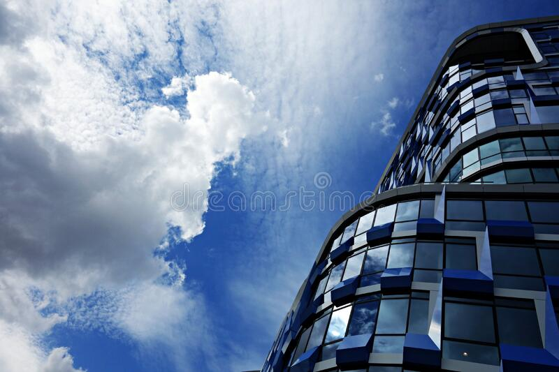 PUBLIC DOMAIN DEDICATION digionbew 10. june july 29-06-16 High rise and clouds LOW RES DSC03732 royalty free stock image