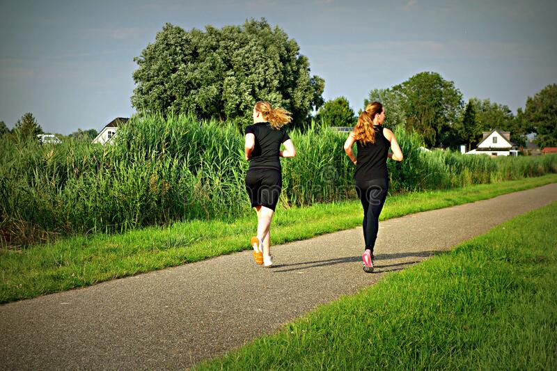 PUBLIC DOMAIN DEDICATION - Pixabay - digionbew 11. 07-07-16 Running girls LOW RES DSC04671 royalty free stock image