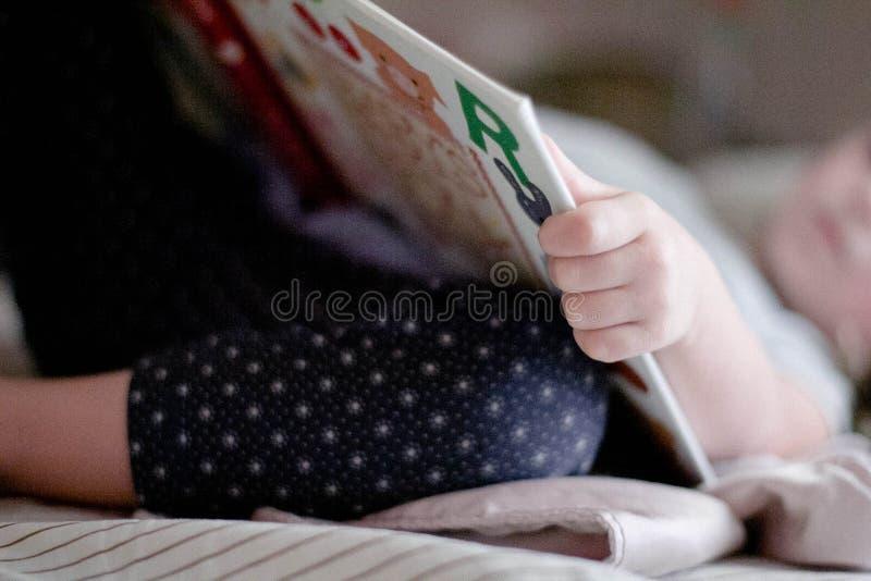 Public Domain- Little Girl Reading Book Bedtime Nap stock photos